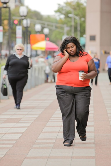 Fat woman with cellphone