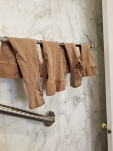 Compression stockings drying on towel rack